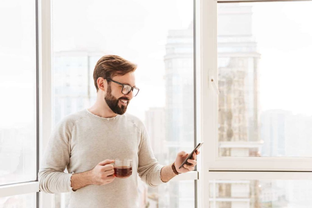 Portrait of a smiling man using mobile phone